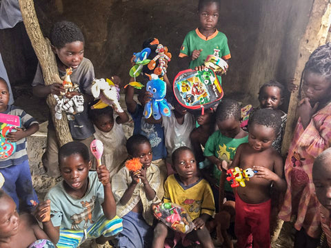 children in village in Zambia sound from a toy caught attention | Kids Travel Boutique