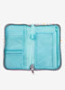 Tiffany blue inside passport pouch and travel document organizer.  lots of pockets and pen holder. Kids Travel Boutique