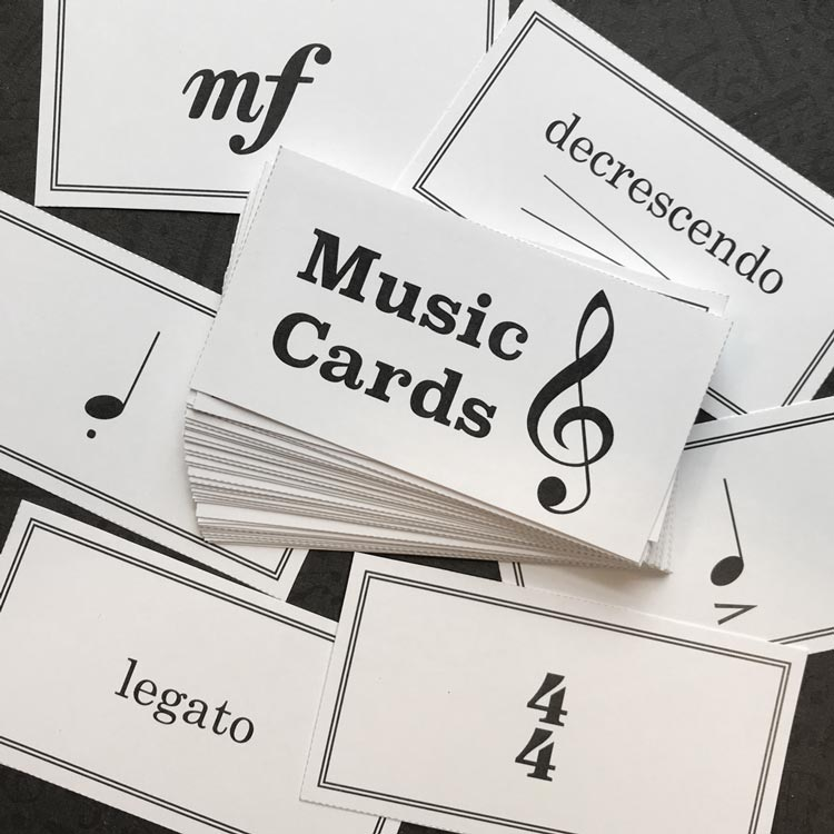 The Music Cards include 39 terms and signs printed with answers on the back.