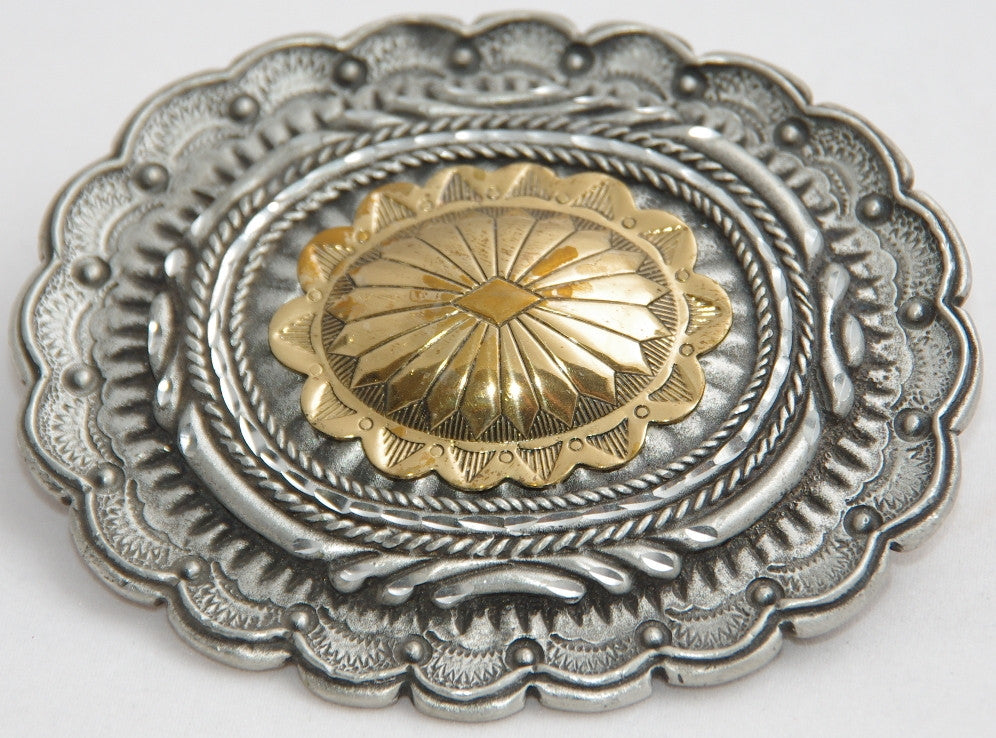 Large conchoe belt buckle, pewter with brass centre. Made in USA