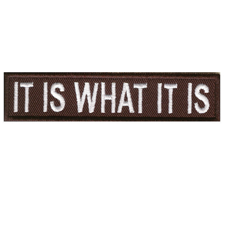 It is what it is, 100 mm wide x 22 mm high, embroided patch