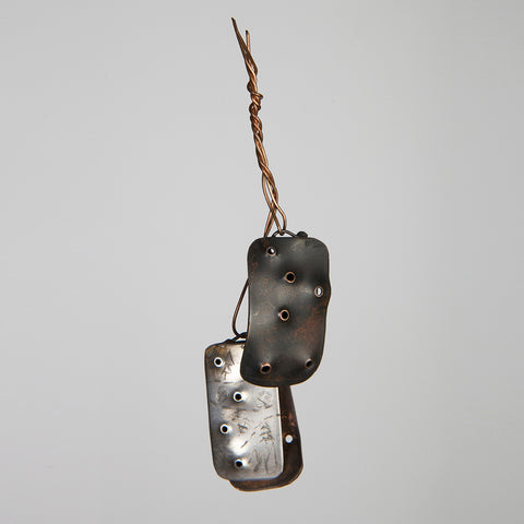 Military dog tag inspired pendant created from copper and silver based on the words duty and weep.