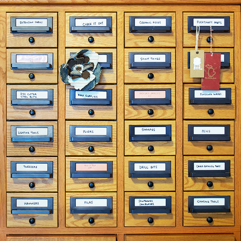 Front view of the card catalog that keeps the tools in the shop organized.