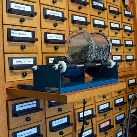 Rotary tumbler sitting on the card catalog.