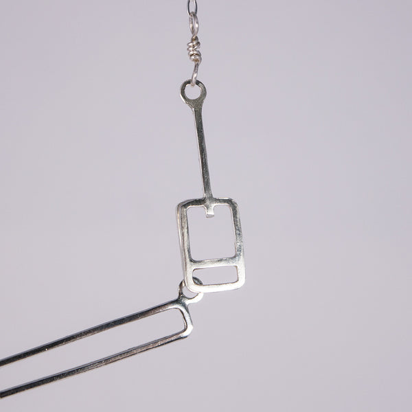 Detail of the lift ticket clasp on the Ski Gondola Necklace