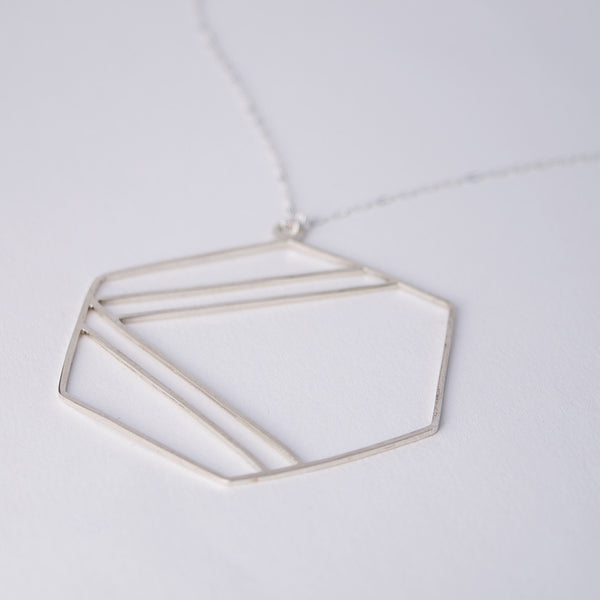Side view of the Hexagon Necklace in sterling silver