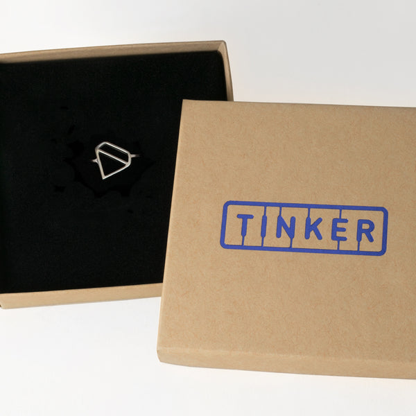 Ice Diamond Ring with an outline of a faceted gemstone shape, from a collection of fun and playful symbolic jewelry by Tinker Company. Shown here in a Tinker gift box.
