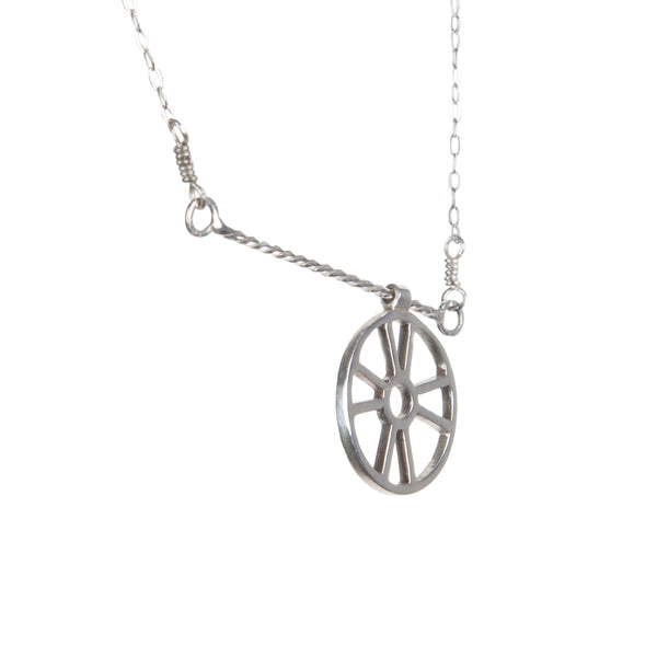 "Kinetic Necklace with Moving Life Preserver has a ring buoy charm that moves across a twisted wire bar necklace designed to look like rope. A great symbolic gift for the ""lifesaver"" in your life, from a collection of kinetic jewelry and playful nautical necklaces."