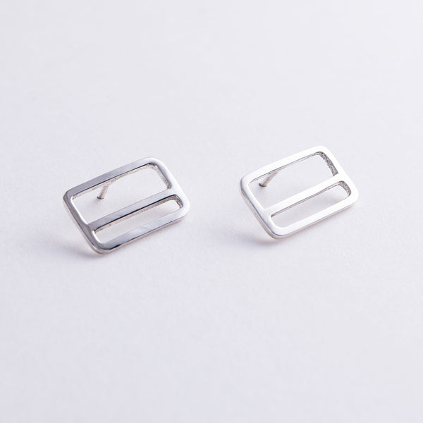 Tinker Company's silver rectangle earrings with a horizontal stripe, design inspired by the NYC Metrocard.