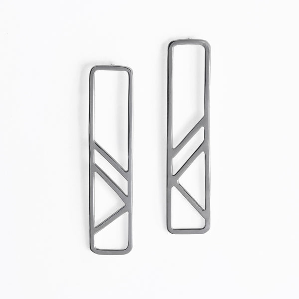 Modern and minimal geometric earrings inspired by the metal column pillars supporting the subway tracks. Part of the City Collection of architectural jewelry by Tinker Company made in New York City.