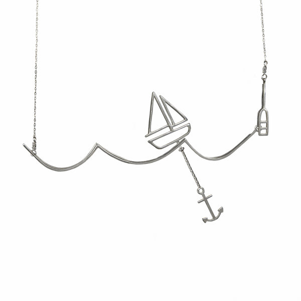 Silver Sailing Necklace with Moving Sailboat on a Wave from a collection of fun and playful kinetic jewelry by Tinker Company.