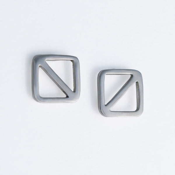 "Geometric nautical earrings in a square shape with a diagonal line, the design inspired by the letter ""O"" nautical flag which is the signal flag for ""man overboard!"" Part of a collection of fun and playful nautical jewelry by Tinker Company."