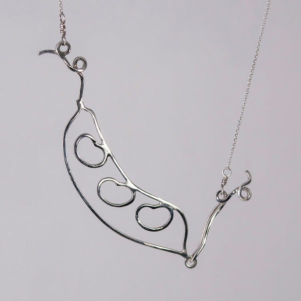 Bean Pod Necklace in sterling silver with three beans, shown in an alternate position