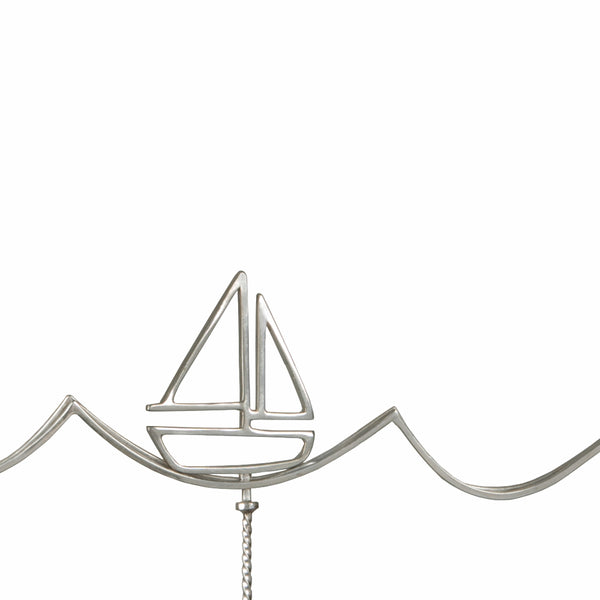 Detail of the Sailboat Necklace with a moving boat from a collection of fun and playful kinetic jewelry by Tinker Company.