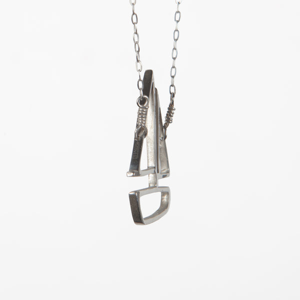 Side view of the Sailboat Pendant in Sterling Silver. From a collection of playful nautical jewelry sustainably made in New York City by Tinker Company.
