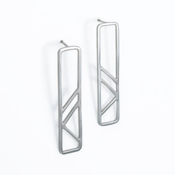 Architectural Pillar Earrings in sterling silver are inspired by the metal column pillars supporting the subway tracks. Part of the City Collection of architectural jewelry by Tinker Company made in NYC.
