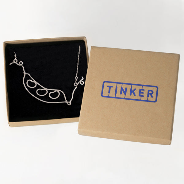 Kinetic Bean Pod Necklace shown in a Tinker Company gift box. This pendant is not just a great gift for gardeners and green thumbs, it's a sentimental piece of jewelry that helps you celebrate all the people in your pod or symbolic garden. Sustainably made in New York.