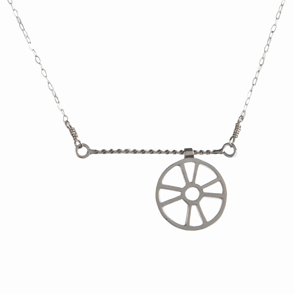 "The Moving Life Preserver on a Rope Necklace has a ring buoy charm that moves across a twisted wire rope bar necklace. A great gift for the ""lifesaver"" in your life, from a collection of kinetic jewelry and playful nautical necklaces."