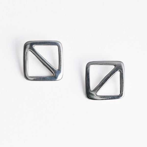 Overboard Flag Stud Earrings in sterling silver, a minimal geometric design inspired by the letter O signal flag, the symbol for man overboard. From a collection of fun and playful nautical jewelry by Tinker Company.