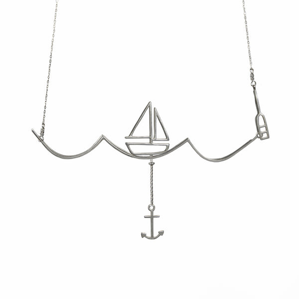 Silver Nautical Necklace with Moving Boat and Anchor on a Wave from a collection of fun and playful kinetic jewelry by Tinker Company.