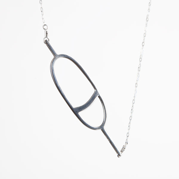 The sterling silver Oval Nautical Buoy Pendant has a simple minimal oval buoy charm on a delicate chain. Sentimental jewelry to remind you of your favorite summer travel and vacation memories on the water.