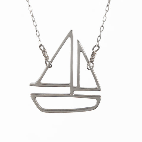 Silver sailboat charm pendant necklace from a collection of playful nautical jewelry made in New York City by Tinker Company.