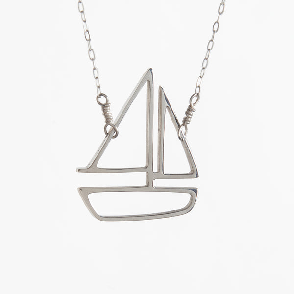 Sailboat Pendant in Sterling Silver. From a collection of playful storytelling memory jewelry celebrating your favorite sailing memories of summer travel and vacation on the water. Perfect for a coastal style summer capsule wardrobe.