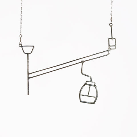 Ski lift necklace with moving gondola on a cable - fun and playful kinetic jewelry by Tinker Company.