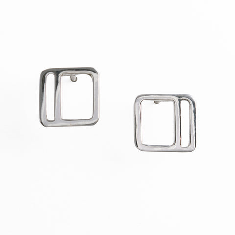 Silver square stud earrings with an offset vertical stripe from a collection of minimalist style geometric jewelry by Tinker Company.