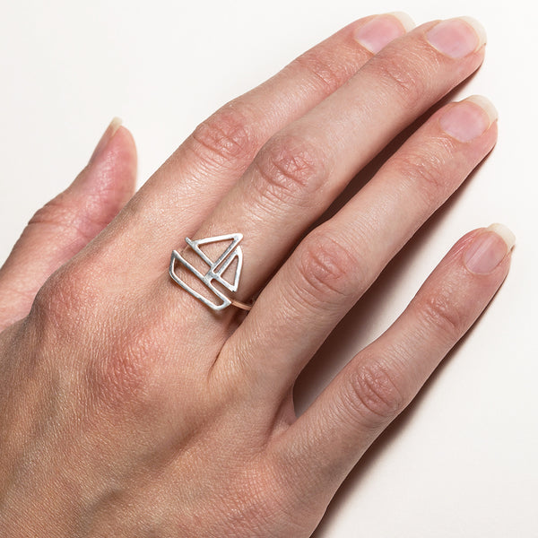 Sailboat Ring in sterling silver, as shown on model's hand. From a collection of fun and playful nautical jewelry by Tinker Company.