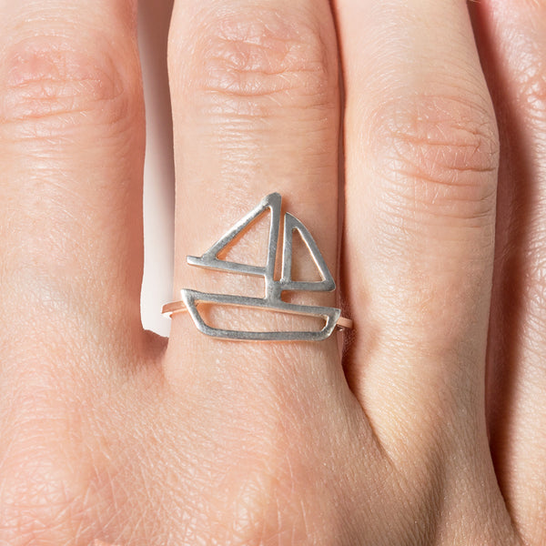 Sailboat Ring in sterling silver, as shown on model's hand. From a collection of fun and playful nautical jewelry by Tinker Company. Sustainably made in New York City.