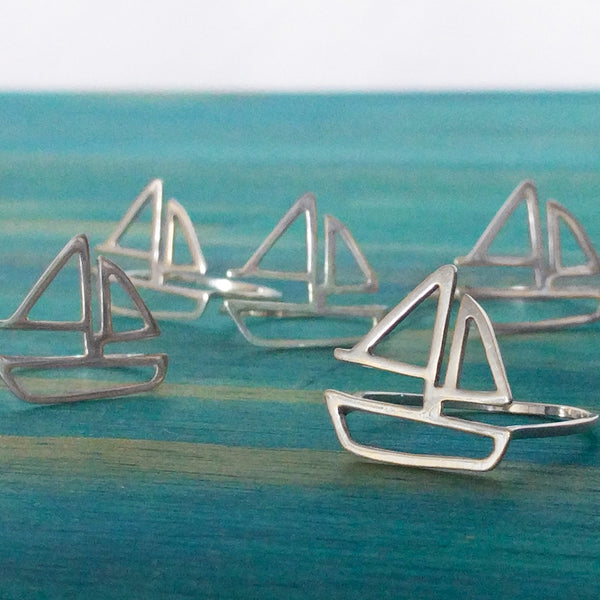 A group of silver Sailboat Rings by Tinker Company. From a collection of fun and playful nautical jewelry designs sustainably made in New York City.