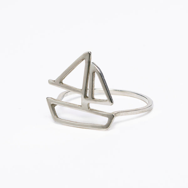 Sterling silver sailboat ring from a collection of modern and minimal nautical jewelry designed to feed your yachting wanderlust and capture your favorite summer sailing memories. Made by Tinker Company in New York City.