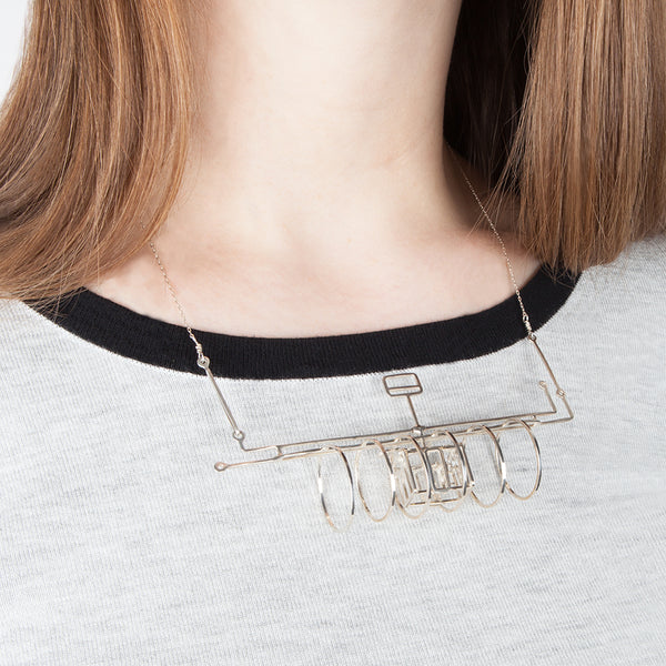 Subway necklace shown on model
