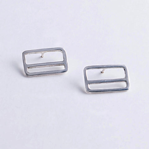 Silver rectangle earrings with a horizontal stripe, design inspired by the NYC Metrocard.