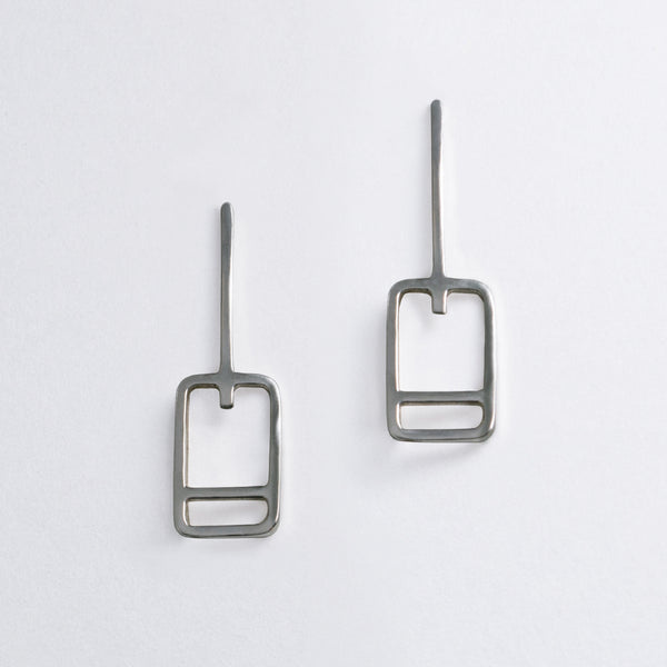 Minimal geometric earrings inspired by the lift tickets at ski resorts. Ski trip memento jewelry designed by Tinker Company.