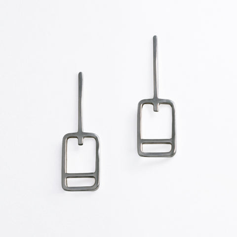 Minimal geometric earrings inspired by the lift tickets at ski resorts. Wear your favorite ski trip memories and feed your winter vacation wanderlust with jewelry designed by Tinker Company.