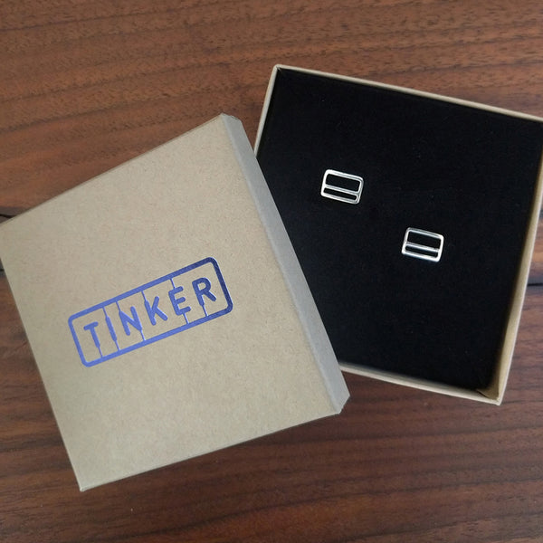 Metrocard Earrings shown in Tinker Company box.