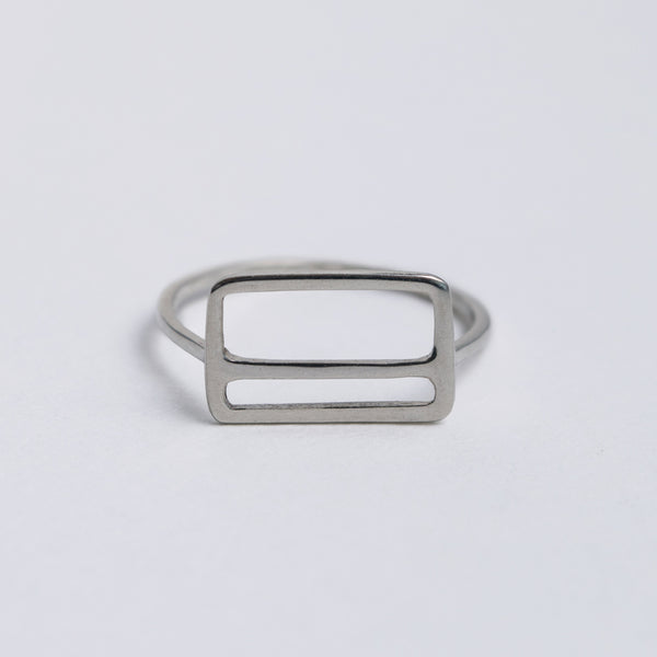 Front view of the Metrocard Ring, the simple design has clean lines with a rectangle outline and an offset horizontal stripe.