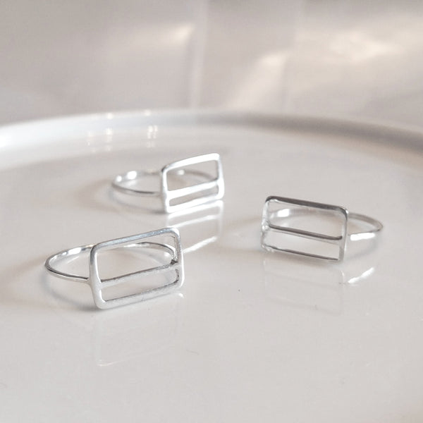 A group of sterling silver Metrocard Rings shown at various angles.