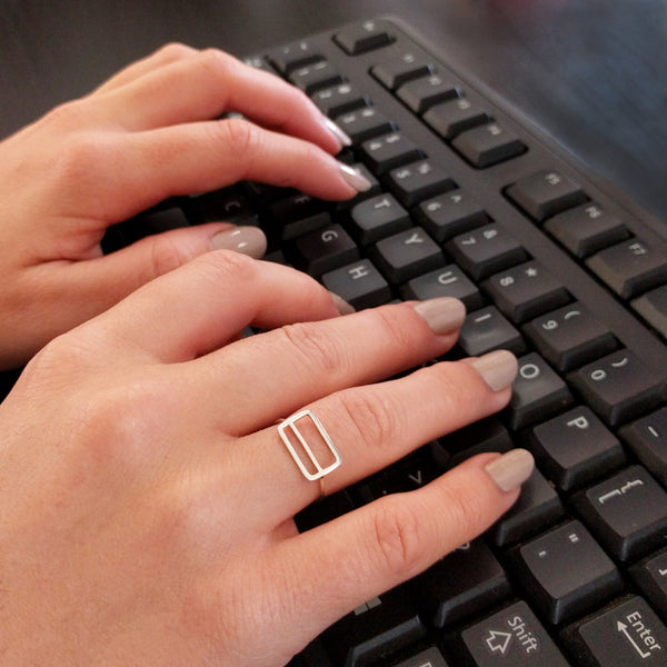 Metrocard Ring shown here on a model's hand while typing on a keyboard.