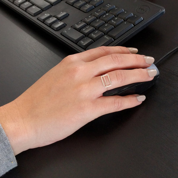 Metrocard Ring shown here on a model's hand while using a computer mouse.