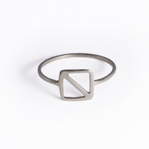 "Sterling Silver Overboard Nautical Alphabet Flag Ring is in the shape of a square with a diagonal line inspired by the letter ""O"" nautical flag, the signal flag for ""man overboard!"" From a collection of symbolic jewelry by Tinker Company."
