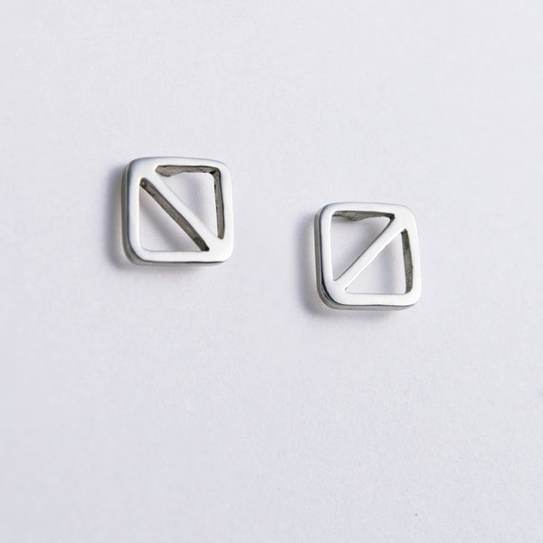 Overboard Flag Stud Earrings in sterling silver, nautical jewelry inspired by the letter O signal flag, they symbol for man overboard.