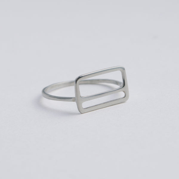 Side view of the Metrocard Ring in sterling silver. A sleek and simple design, this ring is an abstract representation of the NYC subway metrocard.