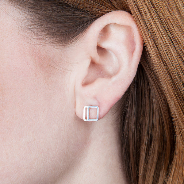 Square Stripe Stud Earring in sterling silver with the vertical stripe option, as shown on a model's ear.