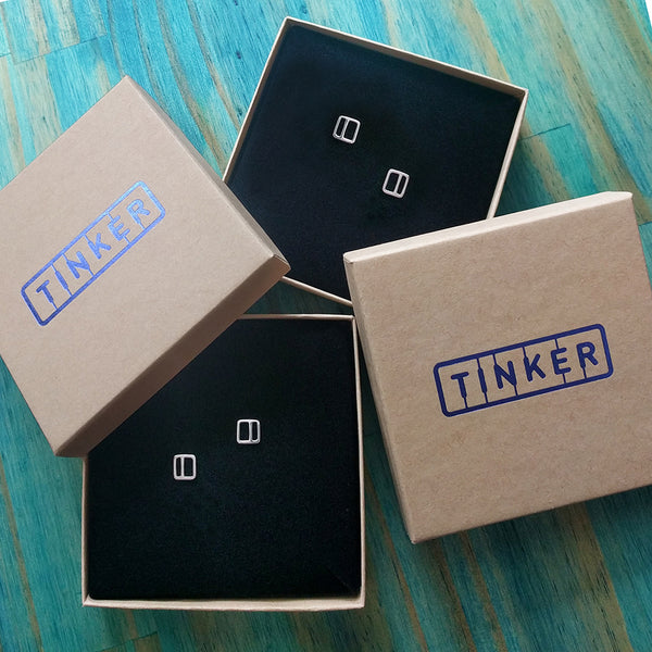 Square Stripe Stud Earrings shown in Tinker boxes.