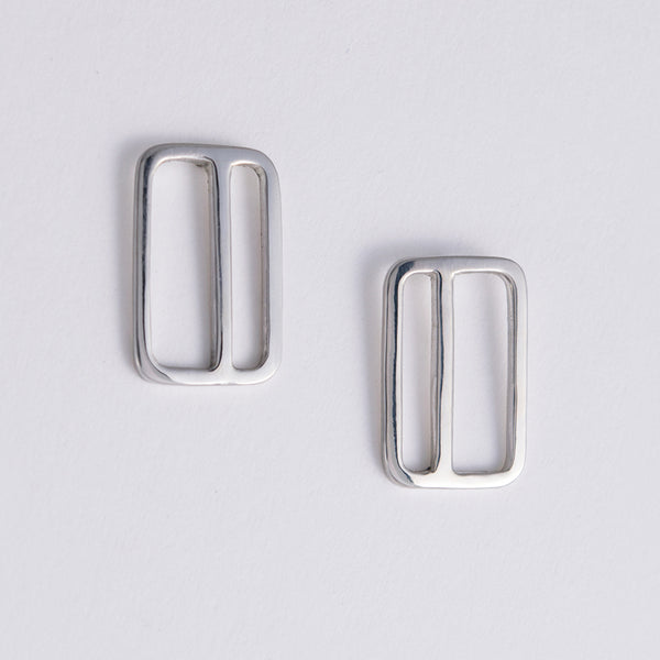 Rectangular Earrings with an offset stripe in sterling silver. Designed and made in New York City by Tinker Company.