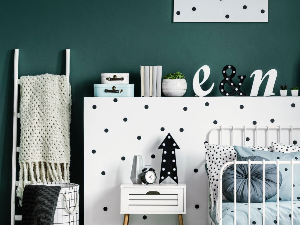 Baby's nursery with black and white bold dots