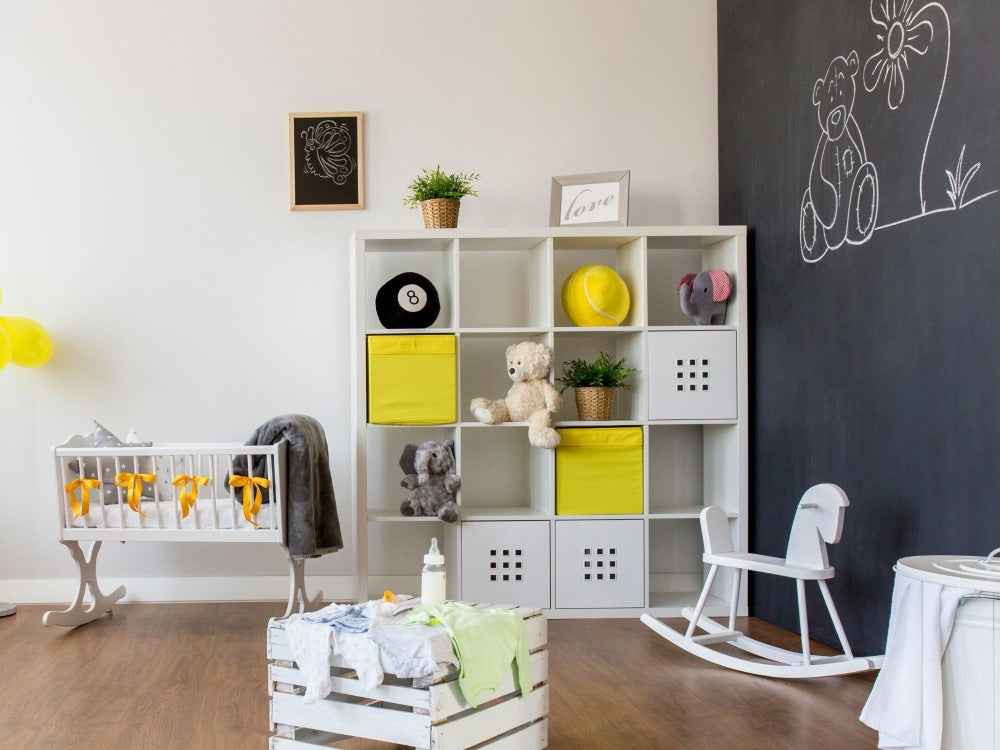 Baby's nursery with large chalkboard wall
